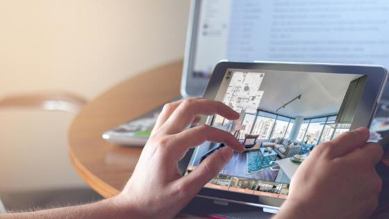 Person on iPad - Panoskin Virtual Tour